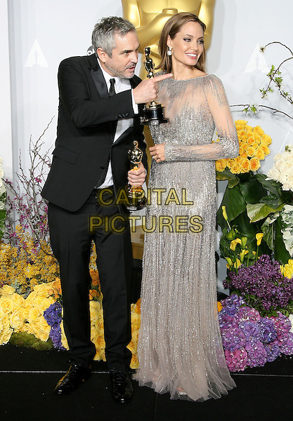 02 March 2014 - Hollywood, California - Alfronso Cuaron, Angelina Jolie. 86th Annual Academy Awards held at the Dolby Theatre at Hollywood &amp; Highland Center.  <br /> CAP/ADM<br /> &copy;AdMedia/Capital Pictures