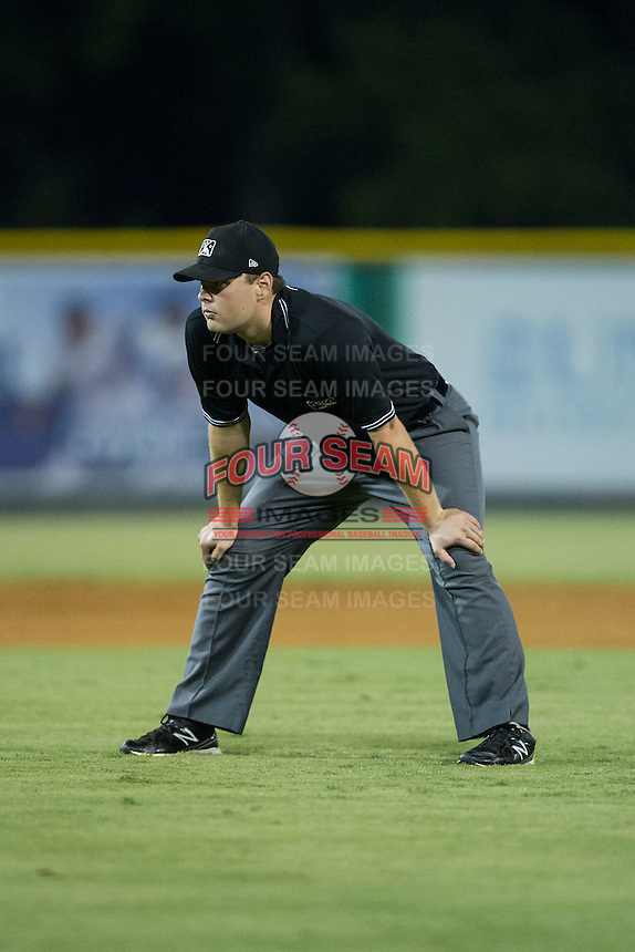 Umpire Nick Susie handles the calls on the bases during the Appalachian League game between the Greeneville Astros and the Burlington Royals at Burlington Athletic Park on August 29, 2015 in Burlington, North Carolina.  The Royals defeated the Astros 3-1. (Brian Westerholt/Four Seam Images)