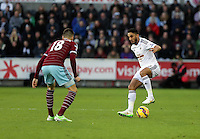 Pictured: Neil Taylor of Swansea (R) against Carl Jenkinson of West Ham (L) Saturday 10 January 2015<br />