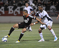 DC United forward Charlie Davies (9) shield the ball against New England Revolution defender Darrius Barnes (25)   The New England Revolution defeated DC United 3-2 in US Open Cup match , at the Maryland SoccerPlex, Tuesday  April 26, 2011.