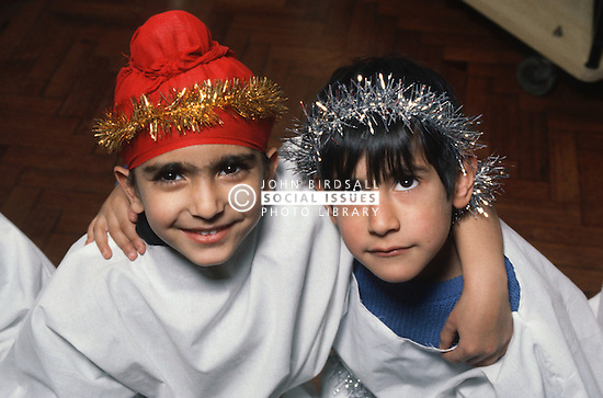 Two young boys wearing dressing up clothes for nativity play,