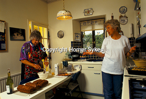 'ENGLISH VILLAGE FETE', MRS EVANS AND MRS STEWART ARE MAKING CAKES THE DAY BEFORE THE AUGUST SUMMER FETE IN THE VILLAGE OF EAST LEACH TURVILLE (GLOUCESTERSHIRE).
