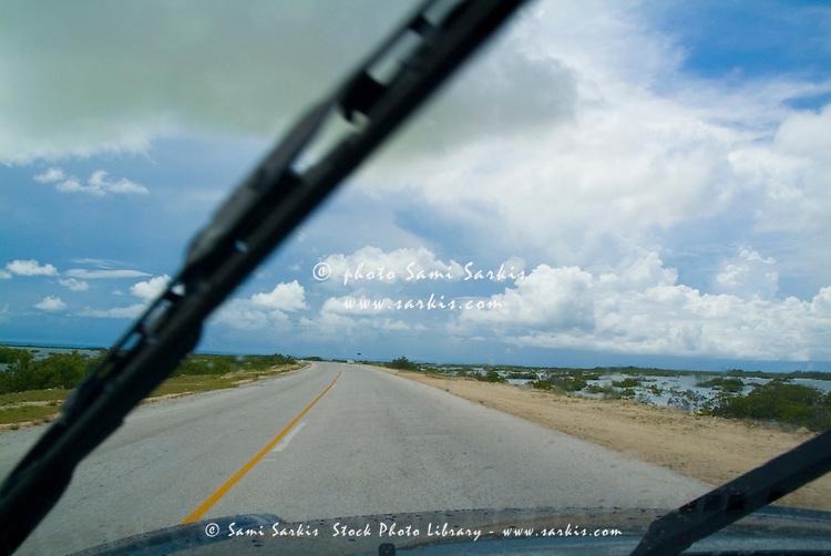 Car travelling on the road leading towards Cayo Santa-Maria, Cuba.