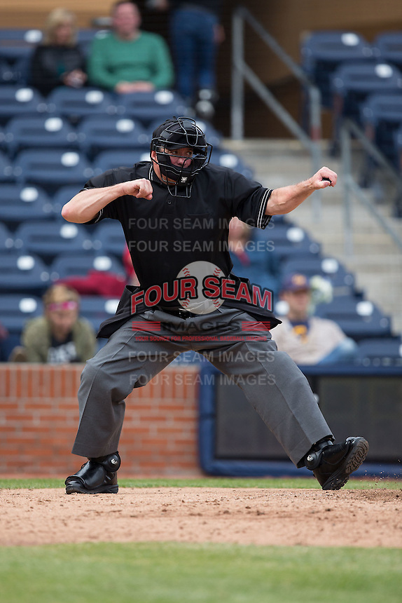 Home plate umpire Reid Churchhill calls a batter out on strikes during the NCAA baseball game between the California Golden Bears and the Duke Blue Devils at Durham Bulls Athletic Park on February 20, 2016 in Durham, North Carolina.  The Blue Devils defeated the Golden Bears 6-5 in 10 innings.  (Brian Westerholt/Four Seam Images)