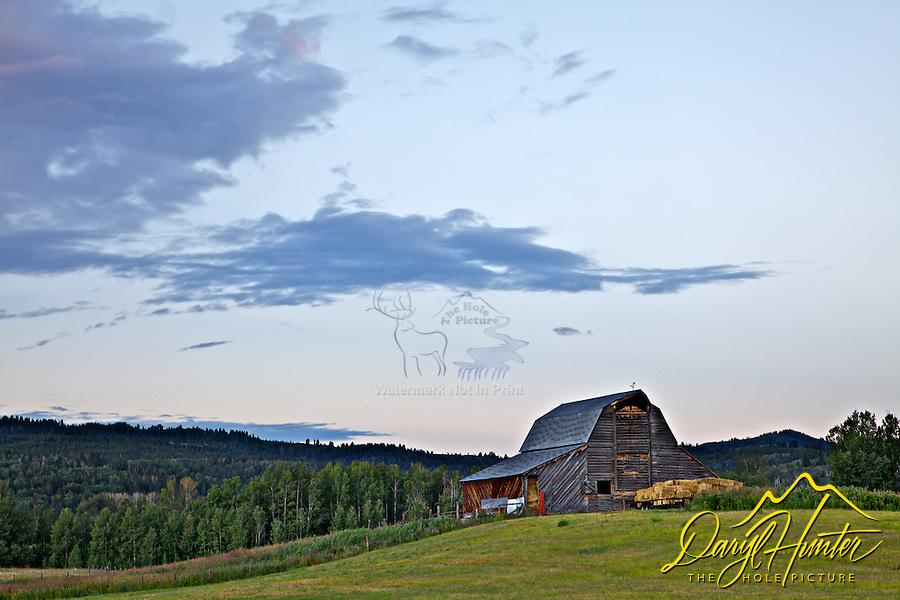 Sunrise over barn in Victor Idaho