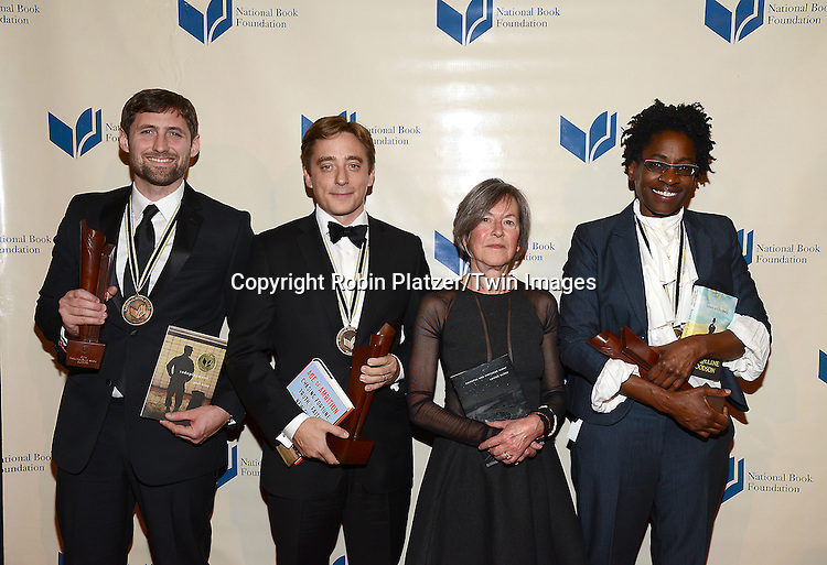 The Winners, Phil Klay, Evan Osnos, Louise Gluck and JacquelineWoodson attend the 65th Annual National Book Awards on November 19, 2014 at Cipriani Wall Street in New York City. <br /> <br /> photo by Robin Platzer/Twin Images<br />  <br /> phone number 212-935-0770