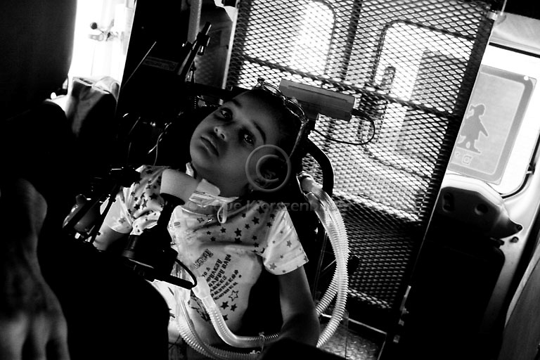 Maryia Aman, a six-year-old Palestinian paralysed from the neck down when the car she was travelling in was caught in a missile attack on a leader of the Islamic Jihad militant group in Gaza, is accompanied by her father Hamdi  to a hearing at Israel's Supreme Court in Jerusalem July 8, 2008. Amin is fighting an order to move her from a rehabilitation centre in Israel to the occupied West Bank.The Defence Ministry, which has covered Maria's medical expenses and sponsored her father and younger brother to live with her at a Jerusalem hospital, has been seeking since last year to send her to Ramallah's Abu Raya Rehabilitation Centre. Photo by Quique Kierszenbaum