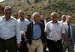 """Palestinian Prime Minister Salam Fayyad attends a ceremony inaugurating a new street in the West Bank  village of Qarawa Bani Hassan near Nablus Wednesday, Sept. 1 , 2010. Fayyad's office issued a statement condemning the Palestinian shooting attack on Tuesday that killed four Israelis, saying it was aimed at undermining his government's effort to build international support for """"the Palestinian position and ending the (Israeli) occupation."""" . Photo by Wagdi Eshtayah"""