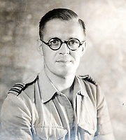 BNPS.co.uk (01202 558833)<br /> Pic: PhilYeomans/BNPS<br /> <br /> Flt Lt Eric Cooper.<br /> <br /> Unearthed - fascinating unseen archive of cameras, photographs, documents and medals from a British aerial reconnaisance expert who fought all the way through Africa and southern Europe in WW2.<br /> <br /> Flt Lt Eric Cooper from London kept all his wartime paraphernalia, including his K20 handheld camera and stereoscopic plotting instruments until his death in Devon aged 96 in 2012.<br /> <br /> The incredible photographs show bombing raids, amphibious landings and badly damaged aircraft alongside off duty snaps of the campaign throughout the mediterraenean.<br /> <br /> His nephew is now selling the compelling collection at Plymouth Auction Rooms in Devon next week.