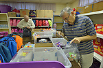 Ed Baxter (left) and Leroy Sanchez assemble backpacks and bags of personal items for women and children who've been released from immigration detention facilities in Texas. The women have fled violence in Central America with their children and were detained by immigration authorities upon their arrival in the United States. After being released in San Antonio, they travel onward to stay with relatives elsewhere in the U.S., pending a final decision on their request for asylum. <br /> <br /> The backpacks and bags are assembled at El Divino Salvador United Methodist Church in San Antonio. The project is sponsored by the Interfaith Welcome Coalition. Baxter is a member of University Presbyterian Church. Sanchez is a member of El Divino Salvador United Methodist Church.