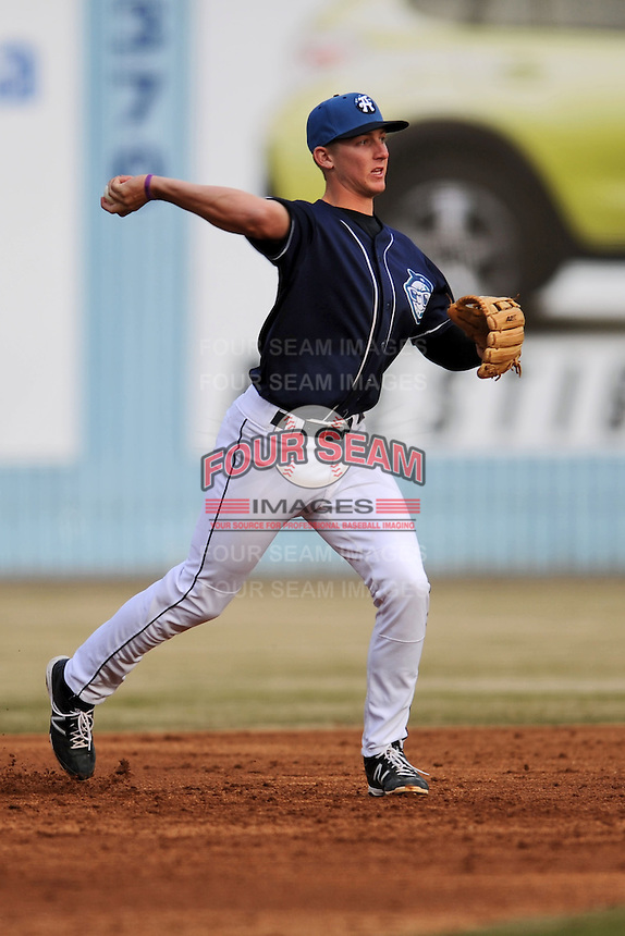 Asheville Tourists third baseman Ryan McMahon #5 during a game against the Delmarva Shorebirds at McCormick Field on April 5, 2014 in Asheville, North Carolina. The Tourists defeated the Shorebirds 5-3. (Tony Farlow/Four Seam Images)