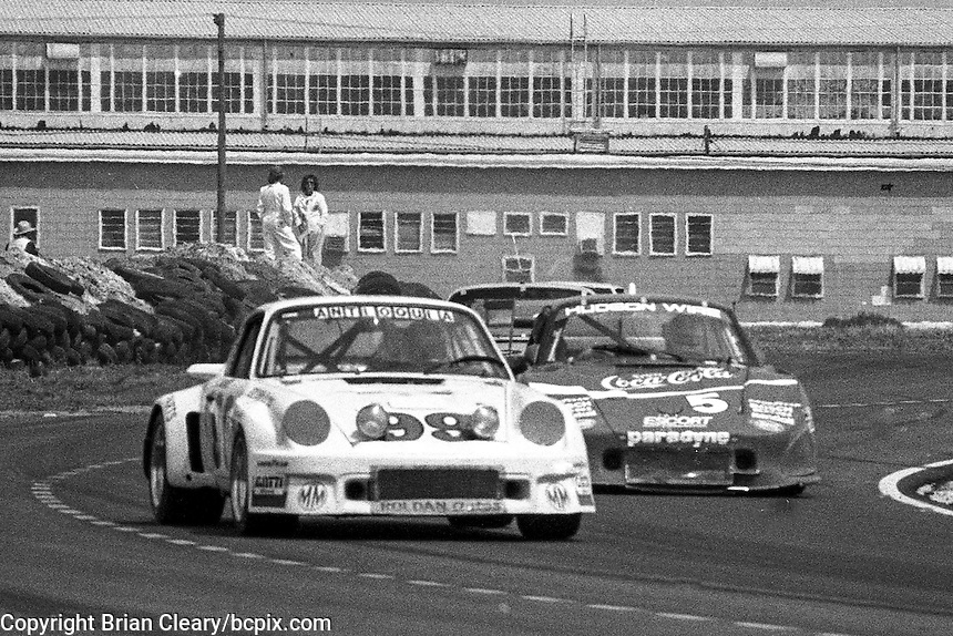#99 Porsche Carrera RSR of Hugo Gralia, Carlos Munoz, and Gustavo Londono (63rd place) and #5 Porsche 935 of John O'Steen, Dale Whittington and Bob Akin (2nd place), 12 Hours or Sebring, Sebring International Raceway, Sebring, FL, March 19, 1983.  (Photo by Brian Cleary/bcpix.com)