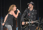 Jennifer Nettles and Kristian Bush of Sugarland perform before George Strait at Reliant Stadium Saturday Aug. 08, 2009.(Dave Rossman/For the Chronicle)