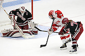 Laura Bellamy (Harvard - 1), Taylor Holze (BU - 24), Kelsey Romatoski (Harvard - 5) - The Boston University Terriers defeated the visiting Harvard University Crimson 2-1 on Sunday, November 18, 2012, at Walter Brown Arena in Boston, Massachusetts.
