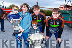 Eanna, Rosalie and Darragh Sheehan from Camp with Colm Moriarty and Killian Falvey as the Kerry minors bring the Tommy Markin Cup and the Munster Minor Cup to the Threshing Festival in Blennerville on Sunday.