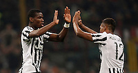 Calcio, Serie A: Milan vs Juventus. Milano, stadio San Siro, 9 aprile 2016. <br /> Juventus&rsquo; Paul Pogba, left, celebrates with teammate Alex Sandro after scoring the winning goal during the Italian Serie A football match between AC Milan and Juventus at Milan's San Siro stadium, 9 April 2016. Juventus won 2-1.<br /> UPDATE IMAGES PRESS/Isabella Bonotto