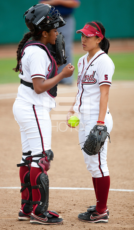 STANFORD, CA - April 2, 2011: Maya Burns of Stanford softball talks to Ashley Chinn at the mound during Stanford's game against Arizona at Smith Family Stadium. Stanford lost 6-1.