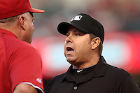 Los Angeles Angels manager Mike Scioscia #14 argues a call with umpire Doug Eddings during a game against the Baltimore Orioles at Angel Stadium on August 20, 2011 in Anaheim,California. Los Angeles defeated Baltimore 9-8.(Larry Goren/Four Seam Images)