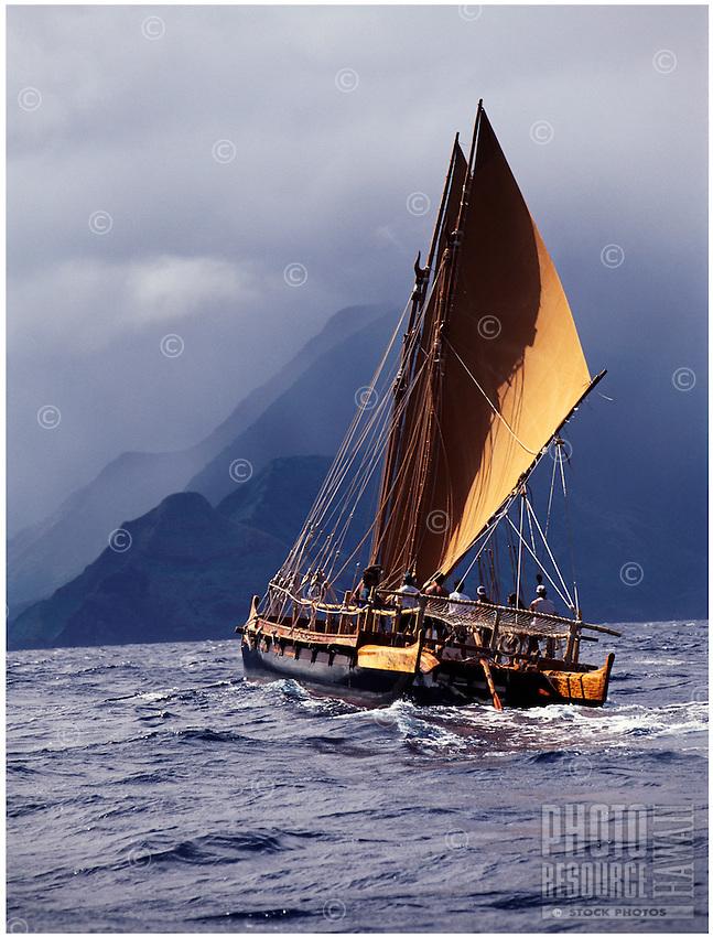 Polynesian voyaging canoe, Hawai'i Loa sails the north shore of Molokai island, Hawaii.