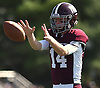 Colin Hart #14, Garden City quarterback, takes a snap during a Nassau County Conference II varsity football game against Carey at Garden City High School on Saturday, Sept. 29, 2018. Garden City won by a score of 38-14.