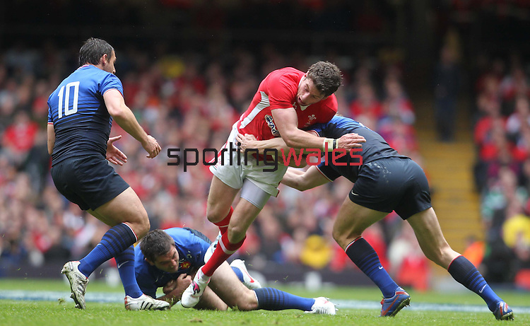 Alex Cuthbert in need of support as he runs into French defence..RBS 6 Nations 2012.Wales v France.Millennium Stadium.17.03.12..CREDIT: STEVE POPE-SPORTINGWALES