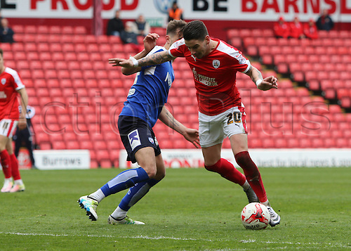 09.04.2016. Oakwell, Barnsley, England. Skybet League One. Barnsley versus Chesterfield. Barnsley's Adam Hammill takes the ball around his defender and into the box