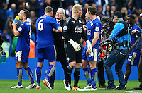 Leicester City manager Claudio Ranieri celebrates with Robert Huth at full time during the Barclays Premier League match between Leicester City and Swansea City played at The King Power Stadium, Leicester on 24th April 2016