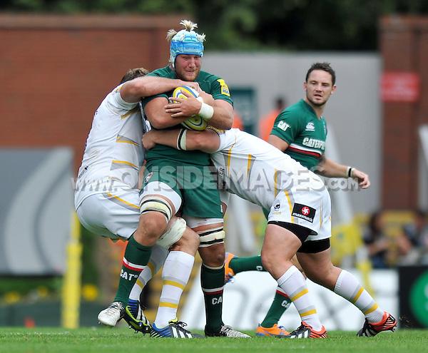 Jordan Crane is double-tackled. Aviva Premiership match, between Leicester Tigers and Worcester Warriors on September 8, 2013 at Welford Road in Leicester, England. Photo by: Patrick Khachfe / JMP