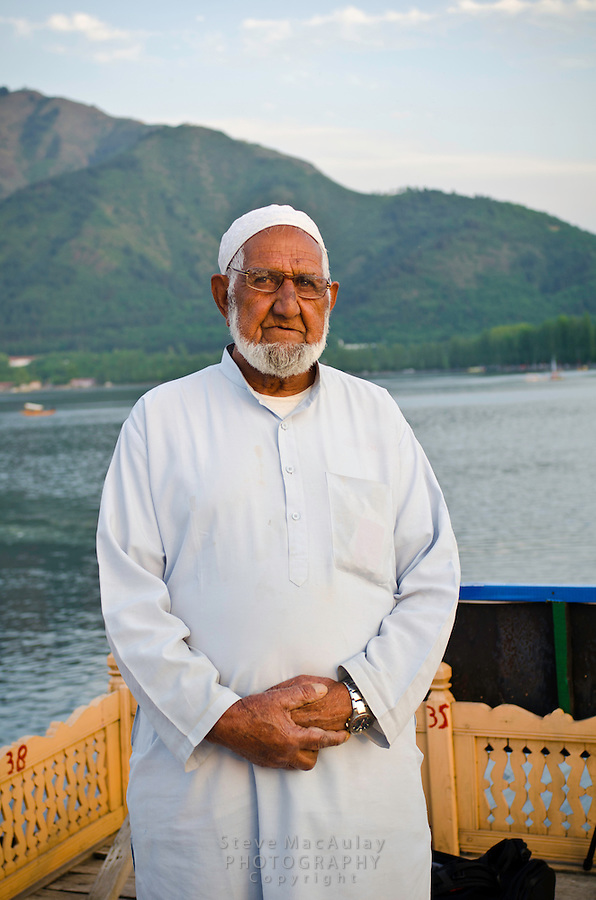 The patriarch of the family poses on the roof of his houseboat, Dal Lake, Srinigar, Kashmir, India