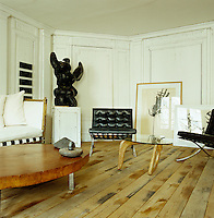 A pair of Mies van der Rohe 'Barcelona' chairs and a Noguchi glass-topped coffee table are amongst the modern designer pieces in the living room
