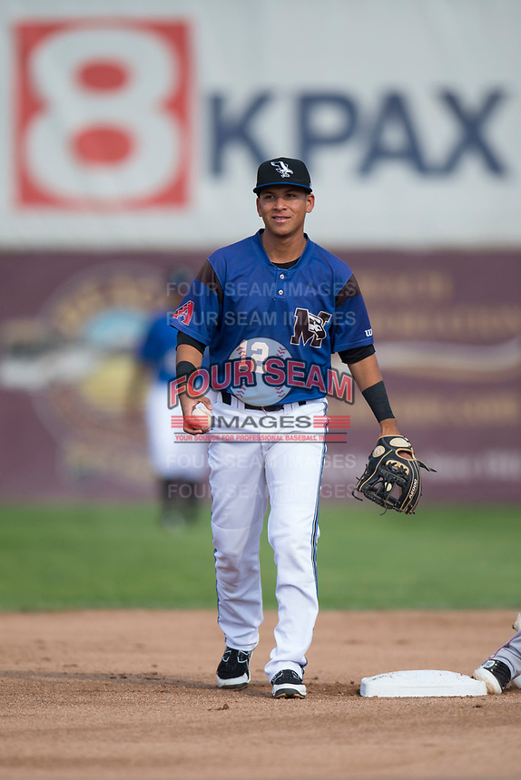Missoula Osprey shortstop Brandon Leyton (12) reacts to the call after applying a late tag to Livan Soto (not pictured) on a stolen base attempt during a Pioneer League game against the Orem Owlz at Ogren Park Allegiance Field on August 19, 2018 in Missoula, Montana. The Missoula Osprey defeated the Orem Owlz by a score of 8-0. (Zachary Lucy/Four Seam Images)