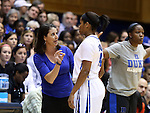 22 March 2014: Duke head coach Joanne P. McCallie (left) talks to Ka'lia Johnson (14) during a break in the action. The Duke University Blue Devils played the Winthrop University Eagles in an NCAA Division I Women's Basketball Tournament First Round game at Cameron Indoor Stadium in Durham, North Carolina.