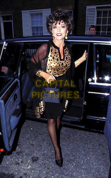 JOAN COLLINS..Ref: 3238..car, taxi, short hair, gold top, animal print, black handbag, little black purse, full length, full-length..www.capitalpictures.com..sales@capitalpictures.com..©Capital Pictures..