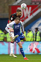 Bolton Wanderers' Mark Beevers competing with Wigan Athletic's Nick Powell <br /> <br /> Photographer Andrew Kearns/CameraSport<br /> <br /> The EFL Sky Bet Championship - Wigan Athletic v Bolton Wanderers - Saturday 16th March 2019 - DW Stadium - Wigan<br /> <br /> World Copyright &copy; 2019 CameraSport. All rights reserved. 43 Linden Ave. Countesthorpe. Leicester. England. LE8 5PG - Tel: +44 (0) 116 277 4147 - admin@camerasport.com - www.camerasport.com