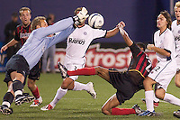 Rapids keeper Scott Vallow makes a stop on Ricardo Clark during second half action. The Colorado Rapids lost to the NY/NJ MetroStars 2-1 on 5/3/03 at Giant's Stadium, East Rutherford, NJ.