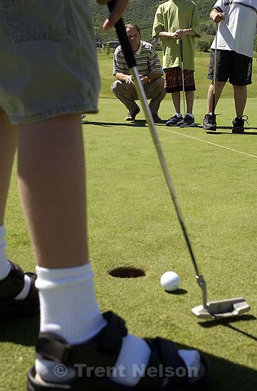 Ryan Rhees, the pro at Bountiful's Eaglewood Golf Course, instructs youth on the practice green in a golf workshop.  06/19/2002, 11:24:13 AM<br />