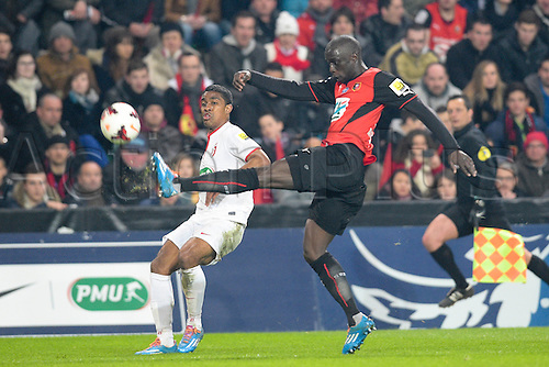 27.03.2014 Rennes, France. Cheikh Mbengue (Rennes) vs Franck BERIA (lille) in action during the Coupe de France quarter final match between Rennes and Lille. Rennes won the match 2-0.