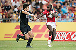 Tone Ng Shiu of New Zealand (left) tries to stop Dennis Onkeo Ombachi of Kenya who runs with the ball during the match New Zealand vs Kenya, Day 2 of the HSBC Singapore Rugby Sevens as part of the World Rugby HSBC World Rugby Sevens Series 2016-17 at the National Stadium on 16 April 2017 in Singapore. Photo by Victor Fraile / Power Sport Images