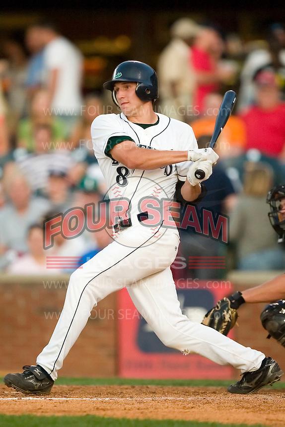 Lexington right fielder Jordan Parraz (8) follows through on his swing versus West Virginia at Applebee's Park in Lexington, KY, Thursday, June 7, 2007.
