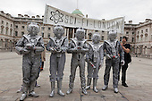 Cybermen from the Doctor Who TV series in the courtyard of Somerset House. About 100 Science Fiction fans dressed up as their favourite characters and gathered in the courtyard of Somerset House to head off for the 4th Sci-Fi London Annual Costume Parade. The parade was organised by Sci-Fi London 14, the London International Festival of Science Fiction and Fantastic Film. The film festival runs until 4 May 2014.