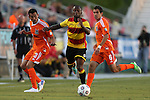 20 April 2013: Fort Lauderdale's Jemal Johnson (ENG) (9) is defended by Carolina's Kupono Low (3) and Austin da Luz (6). The Carolina RailHawks played the Fort Lauderdale Strikers at WakeMed Stadium in Cary, North Carolina in a North American Soccer League Spring 2013 Season regular season game.