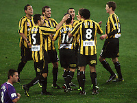 Phoenix players celebrate their first goal during the A-League football match between Wellington Phoenix and Perth Glory at Westpac Stadium, Wellington, New Zealand on Sunday, 16 August 2009. Photo: Dave Lintott / lintottphoto.co.nz