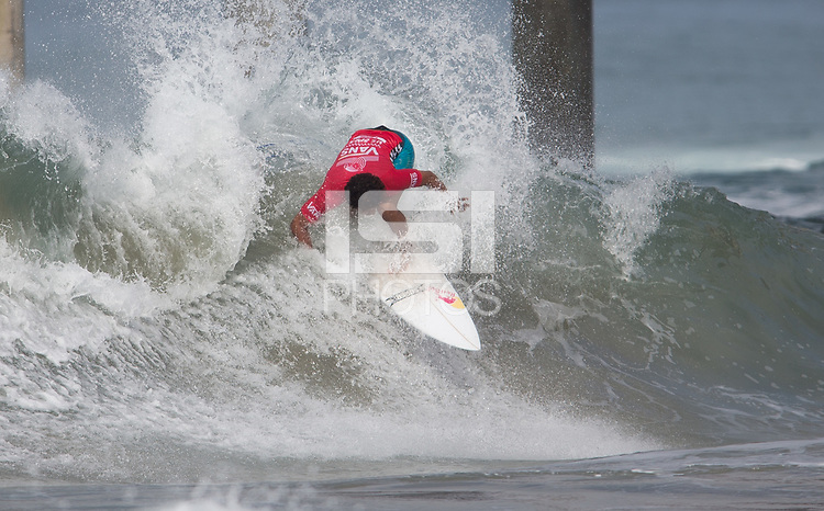 Huntington Beach, CA - Sunday August 06, 2017: Carlos Munoz during a World Surf League (WSL) Qualifying Series (QS) Quarterfinal heat in the 2017 Vans US Open of Surfing on the South side of the Huntington Beach pier.