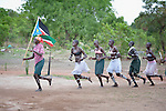 Carrying the flag of South Sudan, students perform a traditional dance at the Loreto Secondary School in Rumbek, South Sudan. The girls' school is run by the Institute for the Blessed Virgin Mary--the Loreto Sisters--of Ireland.