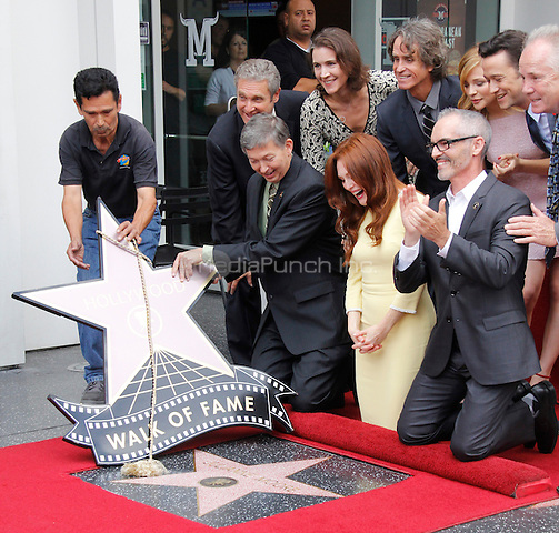 HOLLYWOOD, CA - OCTOBER 03: Actress Julianne Moore is honored with a star on the Hollywood Walk of Fame on October 3, 2013 in Hollywood, California. Credit: Sonboleh/RTN/MediaPunch Inc.