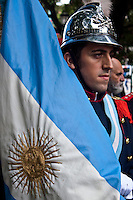 An Argentinian soldier holds a national flag during a commemoration of the Malvinas veteran day in Buenos Aires April 2, 2013. Photo by Juan Gabriel Lopera / VIEWpress.