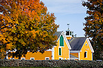 Bright fall foliage surrounds the barns at Eastover Farm in Rochester, MA, USA