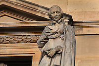 Statue of Louis Bourdaloue, Jesuit preacher, 1632-1704, by Louis Desprez, at the Colbert Wing, in the Cour Napoleon at the Musee du Louvre, Paris, France. A series of 86 statues of famous men were placed in this courtyard 1853-57 under the architects Louis Visconti and Hector Lefuel. Picture by Manuel Cohen