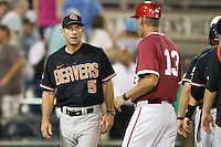 Oregon State head coach Pat Casey (5) talks with Indiana Hoosiers head coach Tracy Smith after Game 9 of the 2013 Men's College World Series  on June 19, 2013 at TD Ameritrade Park in Omaha, Nebraska. The Beavers defeated the Hoosiers 1-0, eliminating Indiana from the tournament. (Andrew Woolley/Four Seam Images)