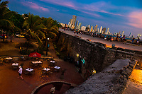 Tourists walk on and along the stone walls, surrounding the colonial walled city, at twilight in Cartagena, Colombia, 14 April 2018. With the peace agreement, ending a 52-year civil conflict and promising political stability, together with rapid economic growth and unexploited tourism potential, Colombia has truly become a holiday destination. Cartagena, a UNESCO World Heritage site on the tropical Caribbean coast, plays the primary role in Colombia's tourism renaissance. The historic sites from the Spanish colonial times are being restored, private investments are visible throughout the city and an increased number of local people benefit from the boom of the travel related services.